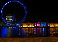 The London Eye and reflections in the Thames River